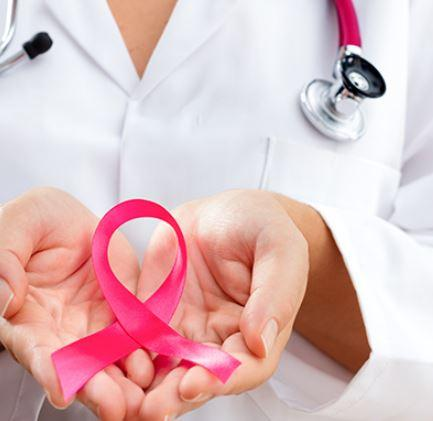 Hands holding a pink ribbon